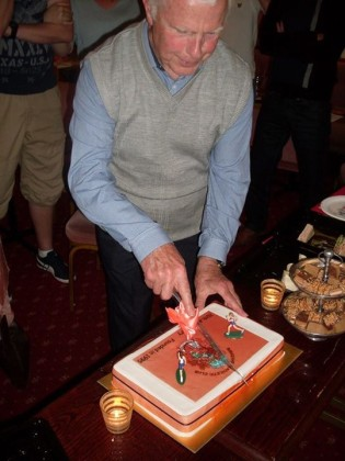 Chairman Lawrie cutting the cake